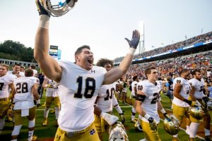 Notre Dame's Chase Hounshell (18) celebrates after the Fighting Irish's win over Virginia Saturday, September 12, 2015 in Charlottesville.