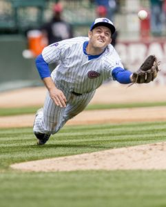 South Bend Cub's third baseman Jason Vosler (21) reaches for a pop fly near the pitchers mound during Thursday's game against the Lansing Lugnuts May 14, 2015 in South Bend.