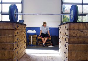 A weightlifter rests during practice at the U.S. Olympic training Center in Colorado Springs.