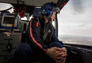 Flight nurse Raenelle Hamilton looks out the window of Memorial's medlight helicopter as it travels from South Bend to Elkhart, Monday, April 11, 2016 in South Bend. Tribune photo/BECKY MALEWITZ