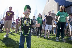 Noah Murawski, 2, uses his whistle while spending time with the Notre Dame Marching Band for the unveiling of this years design for The Shirt, Friday April 15, 2016 in South Bend. Murawski's family contacted the assistant band director to see if it was possible for the young music fan to visit during a practice. Instead, he was invited to Friday's event. The future band member was given his own whistle, taught to play instruments by band members and helped lead the victory march. Tribune photo/BECKY MALEWITZ
