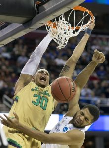 The Notre Dame's Zach Auguste (30) dunks the ball over Kentucky's Andrew Harrison (5) in the second half Saturday, March 28, 2015, in Cleveland. SBT Photo/BECKY MALEWITZ