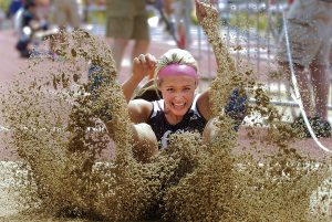 GCHS senior Taryn Tempel lands after one of her jumps in Friday's class 6A long jump competition during the state track meet at Wichita.