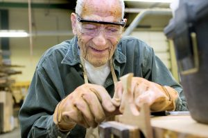 Becky Malewitz/Telegram Carl Bonebrake, 95, works on a project during woodworking class which he takes with his daughter. He is currently making handmade crosses for each of his grandchildren.